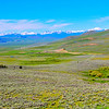 This is Montana Big Sky Country showing a part of the Upper Big Hole Valley above Jackson and Wisdom, MT.     Snow-capped Beaverhead Mountains provide a scenic background.