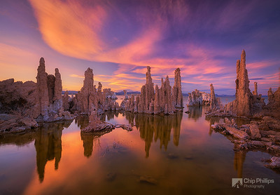 """Mono Lake Sunset""  Warm light at sunset shines on the Tufas and lenticular clouds in Mono Lake California."