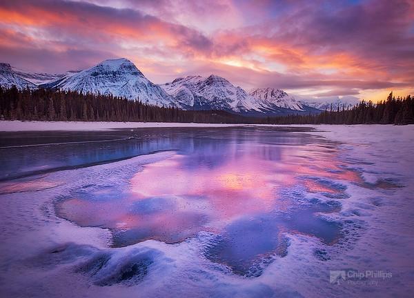 """""""Jasper Sunset""""  Winter sunset over a frozen river in Jasper National Park."""