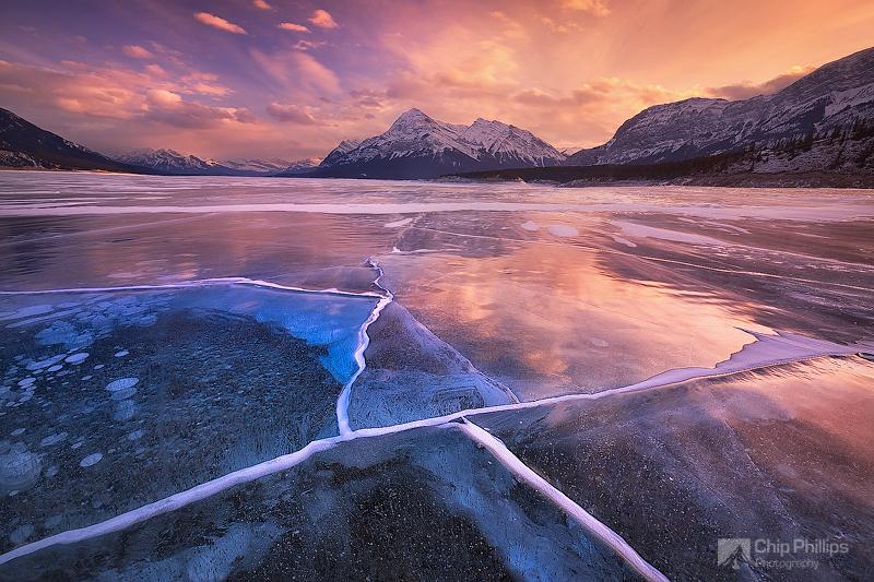 """Abraham Lake Sunset""  Ice cracks at sunset over Abraham Lake in Alberta Canada."