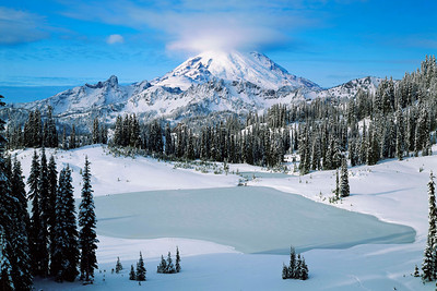 """Tipsoo Lake"" Looking west from Chinook Pass at Mt. Rainier's east face, the first heavy snows of winter cloak the once verdant meadows in white."