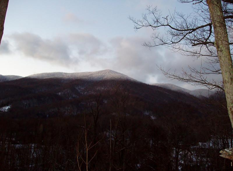 Sun grazes the tip of the peak