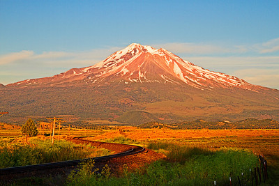 View of Mt Shasta and train tracks looking southeast from Old Highway 99 near Weed, CA