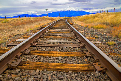 Not the Mainline: These railroad tracks along Old Highway 99 near Gazelle in Siskiyou County, CA still carry an occasional freight train for the Central Oregon and Pacific Railroad. Mount Shasta (14,179 ft) provides a scenic backdrop along much of the route.