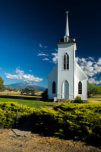 Little Shasta Church, established in 1878, in the Little Shasta Valley near Montague, CA with Mt. Shasta in the background.