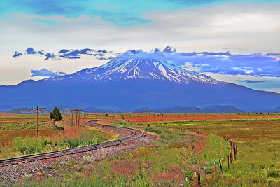 """Dreamland Mt.Shasta"" - a seldom used rail line curves gracefully through the fields near Gazelle, CA as Mt. Shasta looms dreamily in the background. The larger this image is printed the more dramatic it is… a gorgeous palette of subtle fall colors enhances this peaceful landscape."