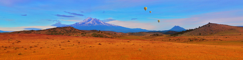 "The High and The Mighty: Hot air balloonists enjoy the scenery in Siskiyou County, CA with Mt. Shasta (14,179 ft.) providing a spectacular backdrop. This image is an 18"" x 72"" panorama designed to fill a large wall space. Cropping from the sides could yield a slightly narrower canvas but would effect the composition."