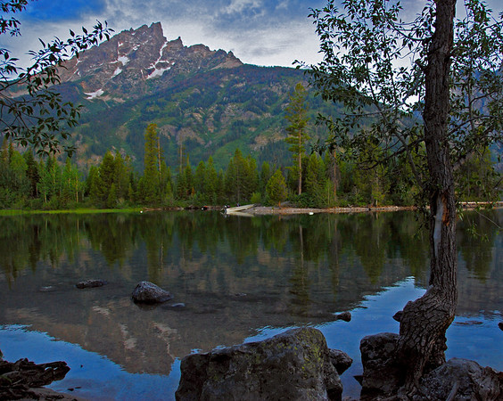 Peacful, Grand Tetons reflecting on Jenny Lake.  I have never seen anything more beautiful than arriving at Jenny Lake in the summer right when the sun was coming up. I will remember that morning for the rest of my life.