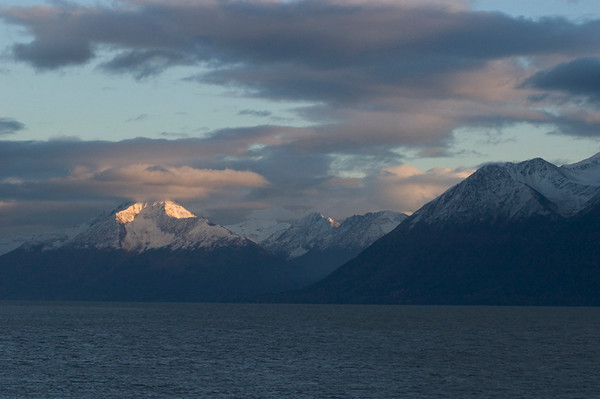 Late Afternoon sun hitting the highest peaks along Turnagin Arm south of Anchorage, Alaska in early Autumn.