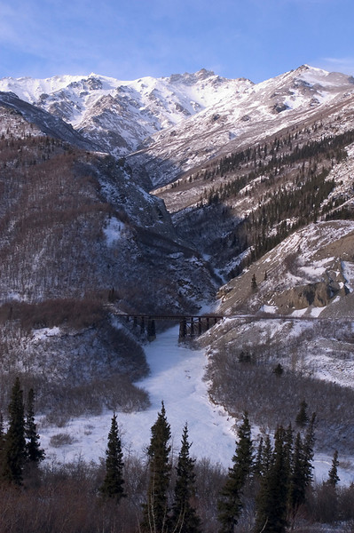 This railroad bridge spans a canyon in the Kantishna Hills in Denali National Park. This photograph was taken about mid-March...temperature near -20 degrees F.