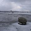THE ROCK<br /> Strengelvåg, Long Friday. The light is more like february than april. But the rock is there as always – adding depth to the wiew.<br /> <br /> THE ROCK<br /> Strengelvåg, langfredag. Lyset minner mer om februar enn april. Men steinen ligger der som alltid – gir sugende dybde i landskapet.
