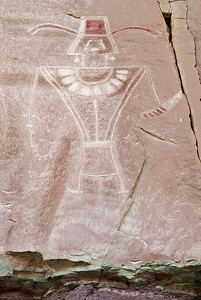 "This tall figure (over 6-feet high on the cliff face) from the McConkie ranch site, north of Vernal, Utah, exemplifies many features seen in Fremont rock art, including headdress, necklace and other adornments, e.g., earrings.  Note also the lines from the eyes indicative of tears.  This ""weeping eye"" motif is mainly found only in Fremont rock art (cf. E. Malotki, Stone Chisel and Yucca Brush)."
