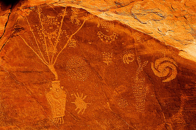 Fremont style petroglyphs at Cub Creek, Dinosaur National Monument, northern Utah.  The glyph on the right resembles some of those at Chaco Canyon, and archeoastronomers suggest they may represent the explosion of the Crab Nebula supernova,  which would have been visible in southwestern skies around AD1000.