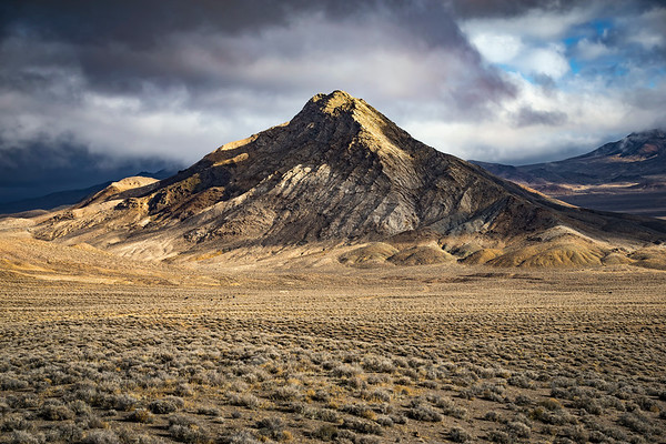 Mountain in the Nevada Desert with dramatic light and clouds.  Chalk Mt.  Middle Gate, NV