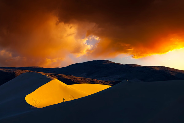 Sand dune at sunrise with photographer on edge of large bowl.  Sand Mountain, Fallon, Nevada