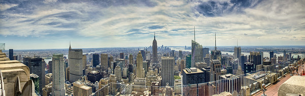 Facing south from the Top of the Rock Observation Deck at Rockefeller Center, which provides a view of the Empire State Building and other New York City landmarks.  The panoramic image was created by merging and blending one (1) row of ten (10) pictures, each bracketed for three (3) exposures -- a total of 30 source files.  The resulting panorama is over 75 megapixels.
