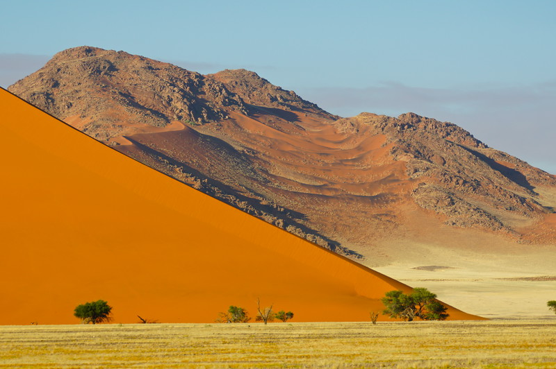Contrast between the sand dune and the rocky mountain behind at Sossusvlei