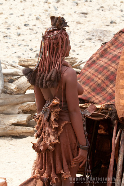 Young adult Himba with traditional jewelry