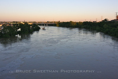 Swollen by three days of nearly continuos rain the Cumberland River roiled into the city like an unstoppable tide.