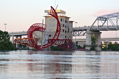 "The city-commissioned sculpture, ""Ghost Ballet"" stands partially submerged on the east bank of the Cumberland River."