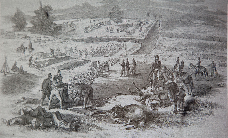 "There were 5000 men killed that morning at this location.  The dead, including horses, had to be buried.  They were usually buried where they fell except Sunken Road was a thoroughfare and had to be cleared.  Frank H. Schell drew this wartime sketch showing trenches dug for the Confederates.  It was printed in Frank Leslie's Illustrated, October 1862, ANB,  The view looks northeast along the lane from the position of where the future Ward house would be built.  Roullete Lane cuts through the center of the sketch.   One eyewitness recalled that the dead ""were in rows like the ties of a railroad, in heaps like sticks of wood."""