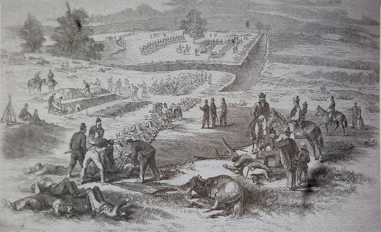 "There were 5000 men killed that morning at this location.  The dead, including horses, had to be buried.  They were usually buried where they fell except Sunken Road was a thoroughfare and had to be cleared.  Frank H. Schell drew this wartime sketch showing trenches dug for the Confederates.  It was printed in Frank Leslie's Illustrated, October 1862, ANB,  The view looks southwest along the lane from the position of where the future Ward house would be built.  Roullete Lane cuts through the center of the sketch.   One eyewitness recalled that the dead ""were in rows like the ties of a railroad, in heaps like sticks of wood."""