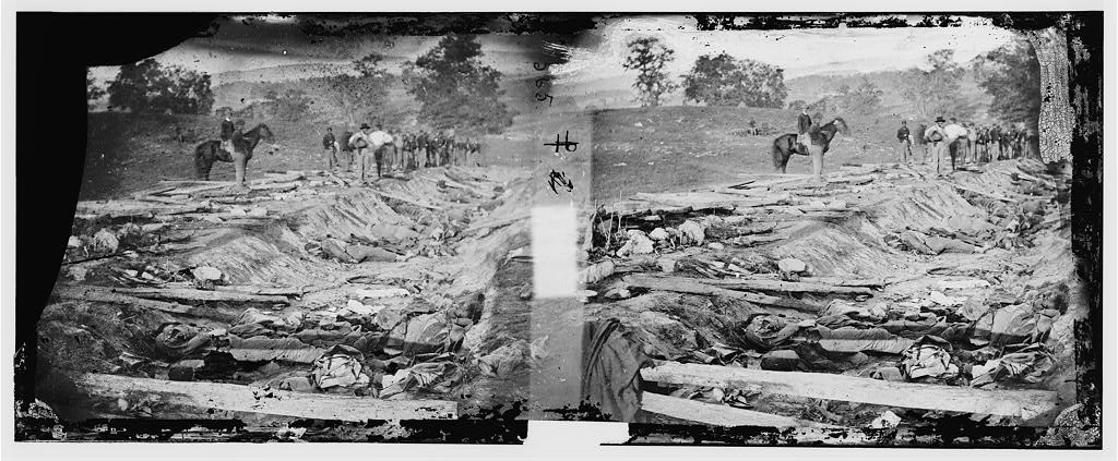 Here is Gardner's original stereo pair.  It is possible to see a great deal more in 3D stereo than possible in a single flat image.  Of the two images above, the one that is normally printed is the right one.  But the left one shows the lane going downhill and to the right at the end of the image.  A point obscured by an emulsion defect on the right image.  Thus Gardner was near the top of the hill.  Secondly, in 3D one can see an significant depression in the earth going down about 6 to 8 feet directly behind the horse.  Also proof he was near the top of the hill. This can not be seen in a flat image.  With the Ward House construction and graves dug near by this area must have been completely filled in over the years.