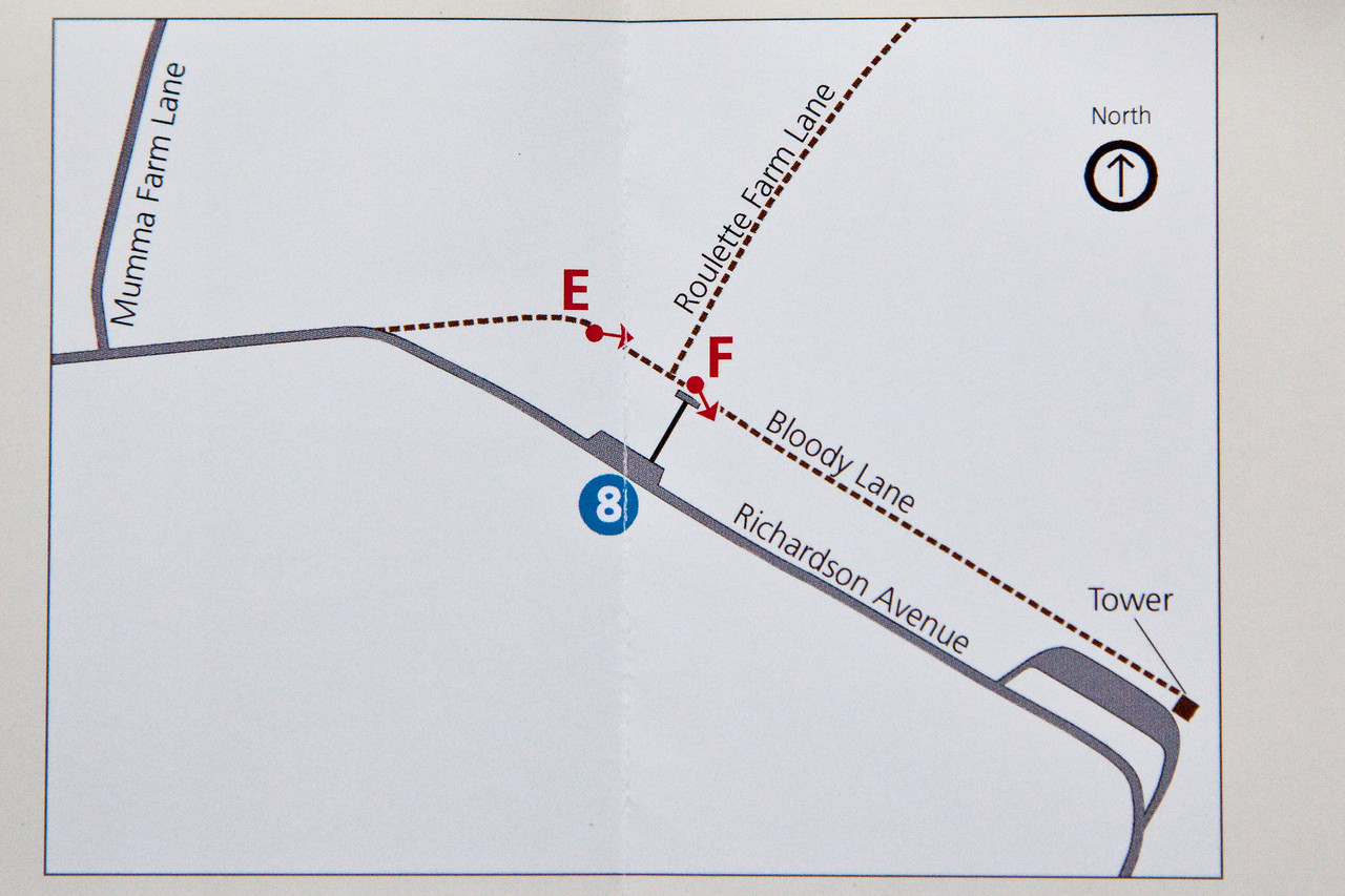 """Here is a map of Bloody Lane courtesy of National Parks Service, """"Photography at Antietam - A Battlefield Tour"""".   The left side of the lane is exactly 82 degrees while the right side is about 115 degrees. You can even put a protractor on this chart to confirm it.  Therefore the point """"E"""" which supposedly indicates where Gardner stood in this publication is incorrect.  Gardner's images must have been taken somewhere between what today is the curve in the road at Richardson's Avenue and the curve in bloody Lane."""