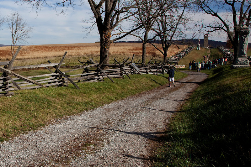 Photograph of Bloody Lane, October 25, 2009, looking South East from a slightly different perspective from the previous image.   In the distance, Brian Baracz, NPS ranger, leads a tour group and describes the battle.