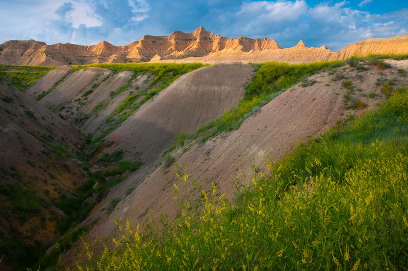 Converging Gully Leading Into Badland Peaks - Badlands National Park, South Dakota
