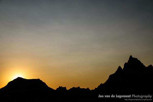 Sunset behind Badlands peaks