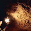 Guide uses lamp to show the formations. Mammoth Cave national Park