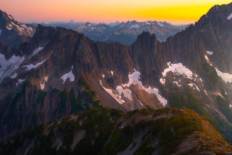 Sun On The Horizon Shining Into The Cascades