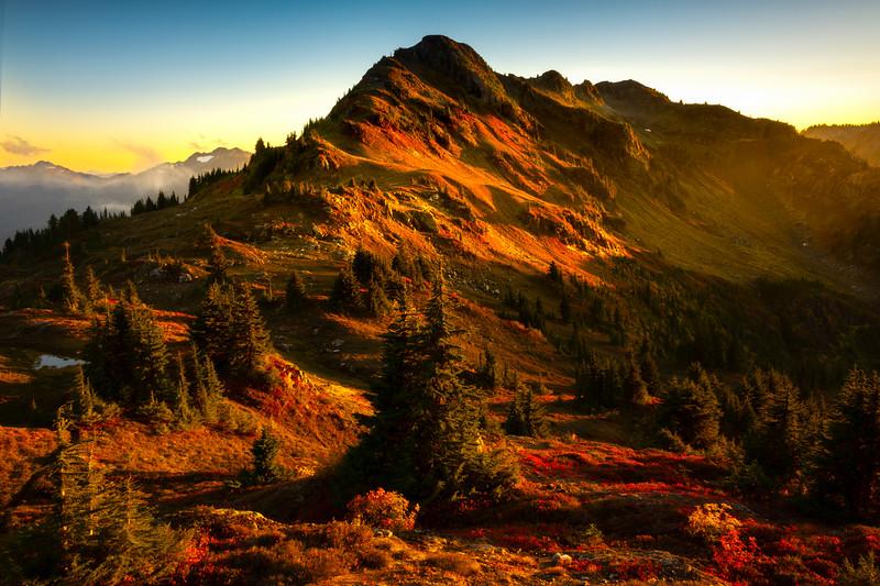 Last Light Illuminating Valley Cascade Peaks - North Cascades National Park, WA