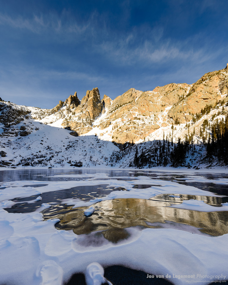 More about this image: http://lagemaat.blogspot.com/2013/03/icy-reflection.html Bigger and Prints: http://lagemaatphoto.smugmug.com/Landscapes/Rocky-Mountain-National-Park/Emerald-Lake/18342876_F69hsQ#!i=2336954031&k=bxnDRsh&lb=1&s=A