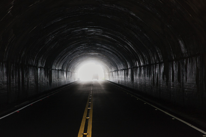 Tunnel on Skyland Drive with truck passing into the fog.