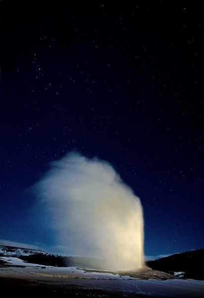 Old Faithful illuminated with two 1 million candle power lamps at Midnight
