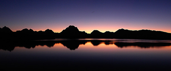Panotramic view of Jackson Lake at sunset.  Mount Moran is at the center.