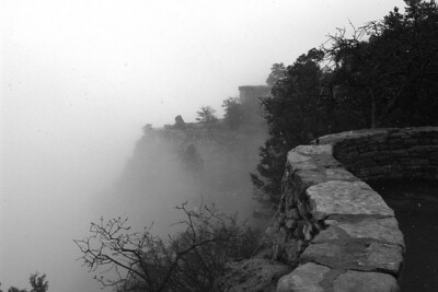 2005-02753BW     A spring snowstorm at the South Rim of the Grand Canyon obscured any views into the Canyon.  But the mist rising from the Canyon and the stone retaining wall proved interesting