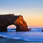 Natural Bridges at Sunset.  Natural Bridges State Park, Santa Cruz, California.  I captured this one winter evening. Just a nice glow in the sky with the waves coming in.