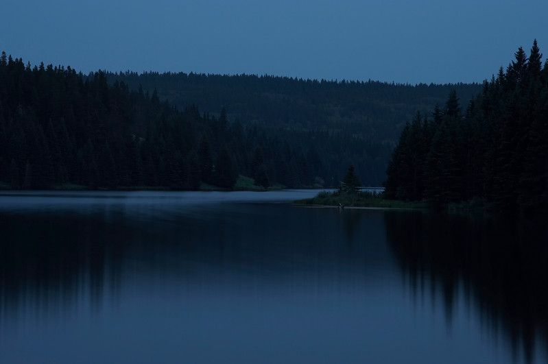 This was taken on the lake shore at Spruce Coulee Resevoir in the Cypress Hills Interprovincial Park, Canada.  The shot was done a short while after the sun had set, with an overcast sky.  And yes, everything did have this slight blue grey tinge to it.  This has to be one of my favourites.