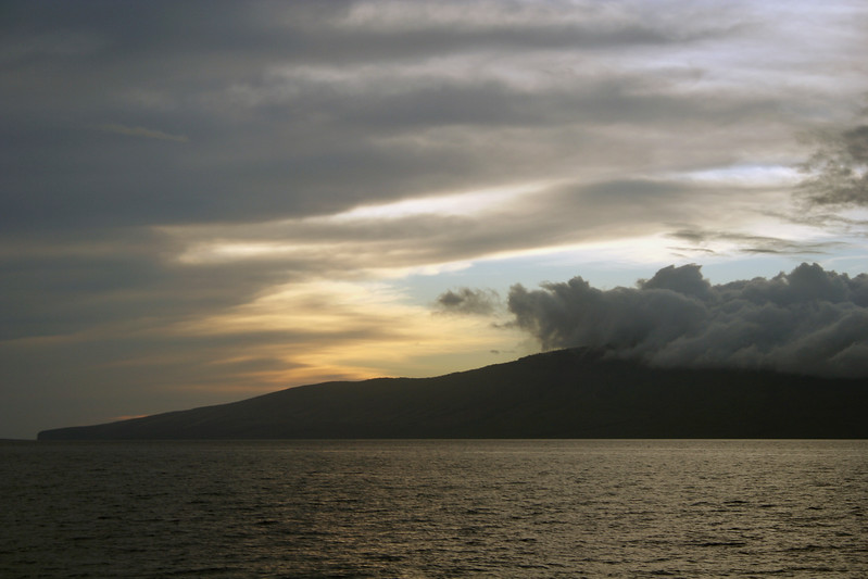 This was taken while on a sunset dinner cruise just off the coast of Maui.  The island in the picture is that of Lanai.