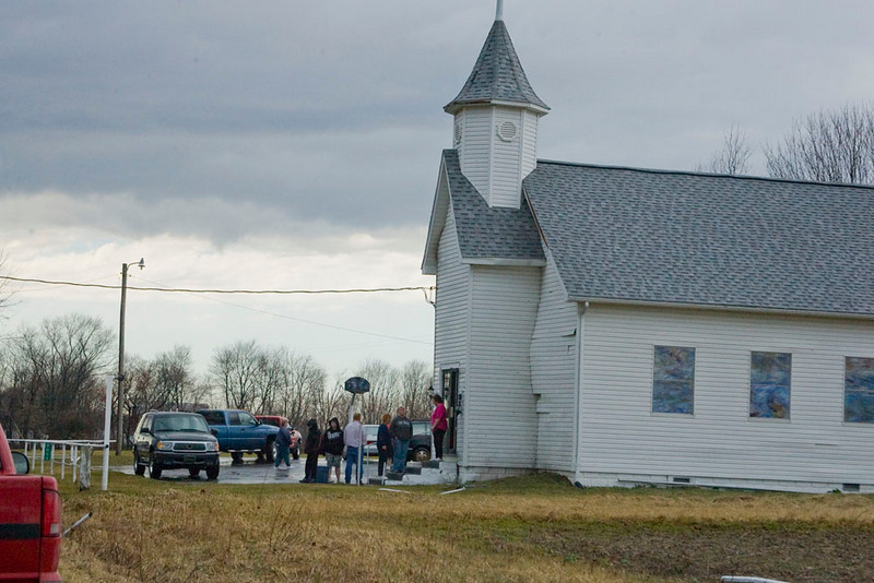 Tornado struck this church about 20 minutes prior to this photo.  Shiloh Church of Christ, south of Odon, Indiana, March 8, 2009.  All windows on the west side of church were broken and siding was hanging off.