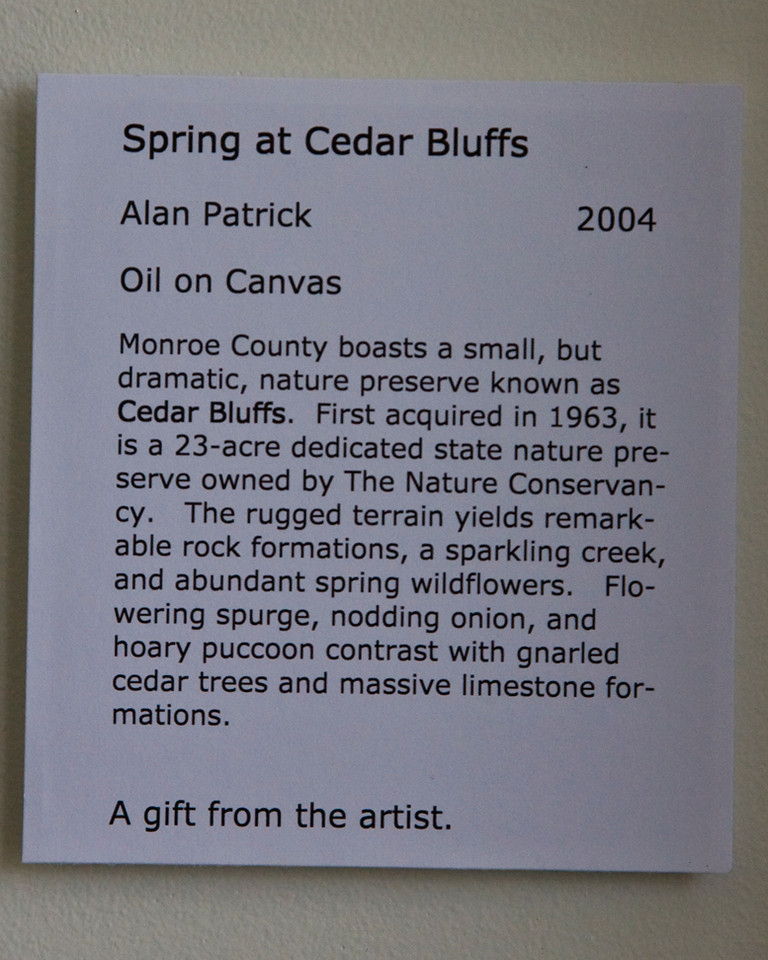 "Many photograph and paintings adorn the building walls.  See next photo for ""Spring at Cedar Bluffs"" painting."