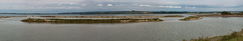 The Oysterbed Reserve, North Hayling<br /> Managed by the Hampshire & Isle of Wight Wildlife Trust.<br /> The island in front is the South Island and the one to the right is the North Island. The lagoon is fed with sea water via the weir just behind the North Island. The hill in the background is Portsdown Hill wich runs from Havant in the East to the outskirts of Fareham to the West and rises to a maximum of about 320 feet.
