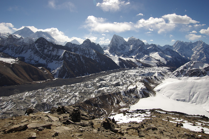 Everest Panorama from Gokyo Ri. The top of Mount Everest is clearly visible on the lefthandsite of the picture (including the Nuptse Ice wall). Mount Makalu, the fifth highest peak in the world is a small dot as the West-face of Cholatse is dominating the view. You can also see Gokyo Village next to the Gokyo Lake