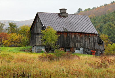 An old barn near South Randolph, Vermont, on Hwy 14. At the back of the barn, gravity is winning the battle of time.