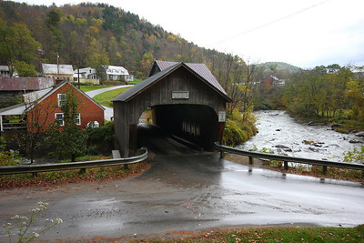 INTERESTING STORY ON THIS ONE. The original Mill Bridge in Tunbridge, Vermont was built here in 1883. It was knocked off its mounts and slowly carried away by a huge ice jam in the rapid spring thaws of 1999. Ironically, the damaged and unrecoverable bridge had to be set ablaze to keep from taking out other historic bridges downstream. This new bridge was built the following year exactly like the old one. I mean EXACTLY-four teams of oxen pulled the new, fully completed 50 ton structure into its final position! At $230,000, the new bridge cost less than the cheapest steel/concrete version, but still quite a bit more than the original bridge, which ran up a tab of $523.32.