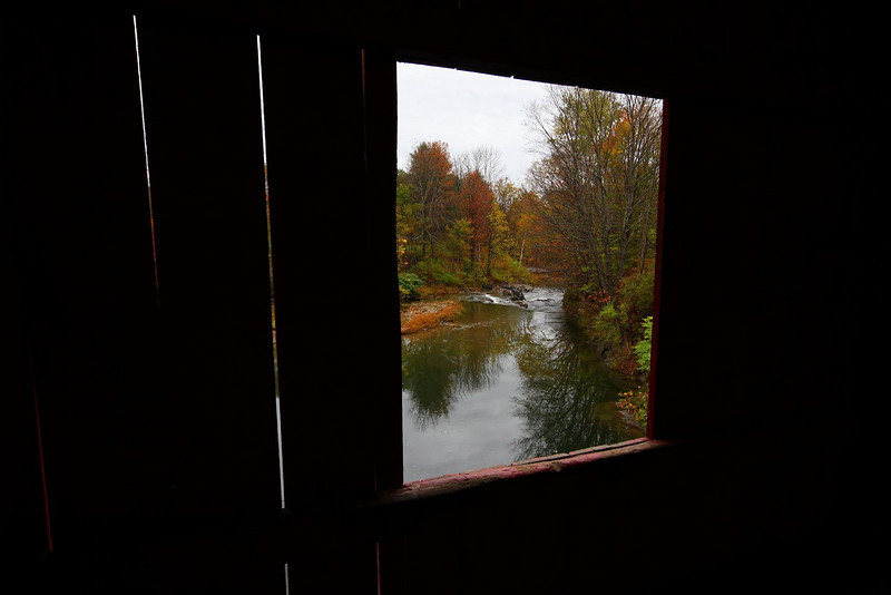 View of the Dog River looking North from inside the Slaughterhouse Bridge in Northfield Falls, Vermont.