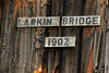Larkin Bridge sign. This sign is a replacement of the original but obviously done in a period style. Local preservation societies gather records and old photos of these bridges to assist in getting repairs and rebuilds done with a high level of historical accuracy.